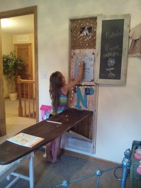 repurposed antique ironing board cabinet into a desk
