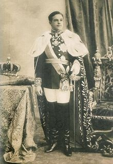 "Dom Manuel II(1889–1932)was the last King of Portugal, ""the Patriot"" or ""the Unfortunate"" ascending the throne after the assassination of his father, King Carlos I of Portugal, and his elder brother, Luís Filipe. His reign ended with the 5 October 1910 revolution, and Manuel lived the rest of his life in an exile enforced by the new Portuguese First Republic. He died unexpectedly and The Portuguese government, at that time ruled by Salazar, authorized his burial in Lisbon, after a state…"