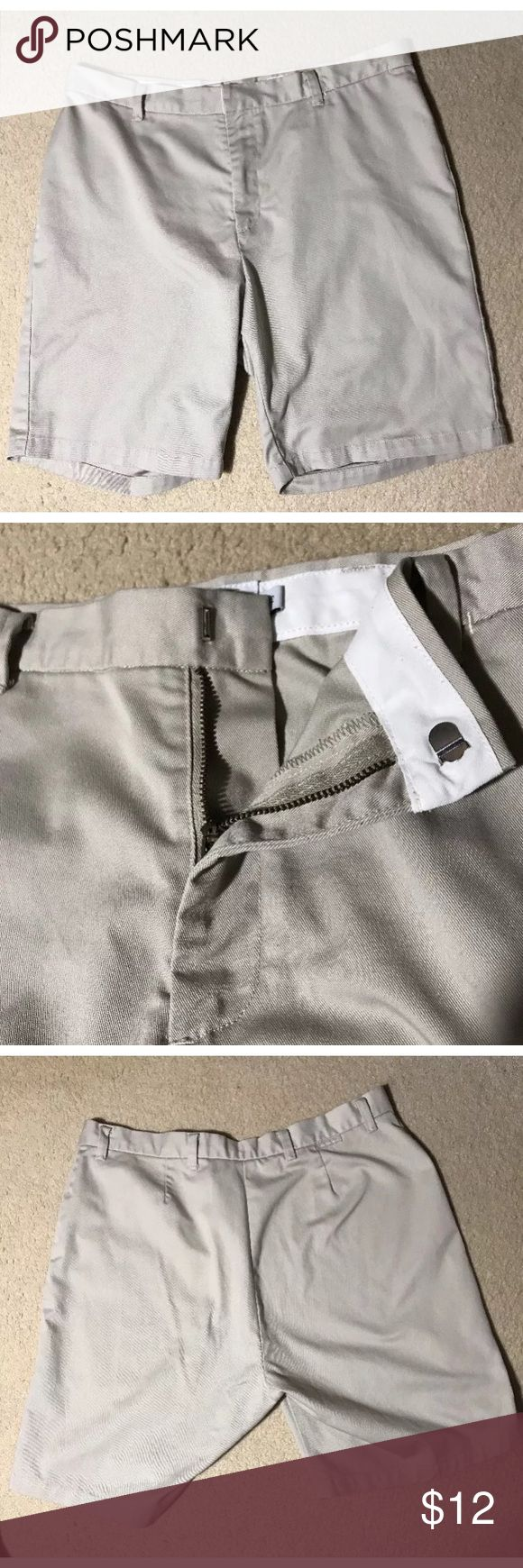 """🌷Calvin Klein Light Beige Bermuda/Walking Shorts Excellent Pre-loved Condition! Calvin Klein Womens Light Beige Bermuda/Walking Shorts Flat Front 8"""" Inseam Size 12 Size: 12 Measured laying down flat: 18.5"""" in length, 17"""" across waist 8"""" inseam Material: 65% Polyester 35% Cotton Description: Very Nice Condition Light Beige Walking/Bermuda Short Clasp hook and zip front. One small front pocket. Check your measurements, no stretch in fabric.  Comes from a Smoke Free Home Calvin Klein Jeans…"""