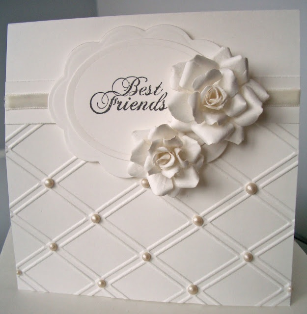 Added the pattern with a Sizzix embossing folder and my trusty pearl maker pen. The roses are made using the Spellbinders' Rose Creations die.