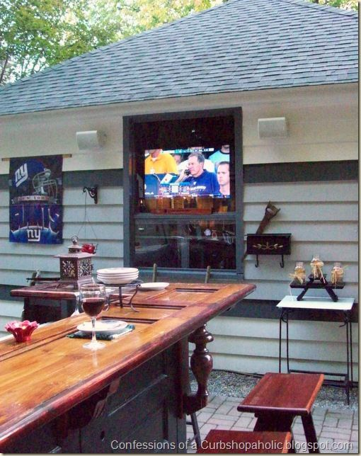 Outdoor Kitchen Using Old Doors As Cabinet Cladding