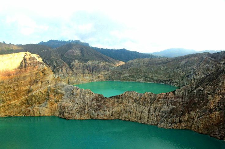 One of the highlights in Ende is the multihued Kelimutu Lakes. Two of the adjacent lakes display turquoise water during this season, as the other one is dark brown.