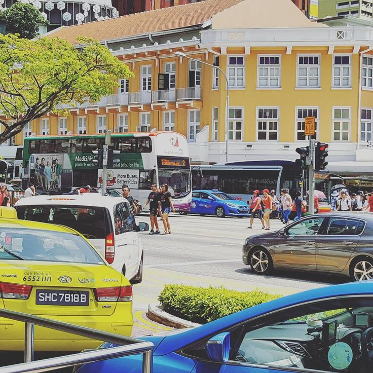 (Photo grid 2/3) #Bugis #Street taken from Bugis #Junction  Taken with my #Samsung #Galaxy #Note 5  #people #transport #taxi #car #singapore #happy #mastercard #market #plaza #retro #architect #building #city #cityscape