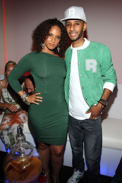 "Alicia Keys with her husband in green. Love this ""slinky"" dress :)"
