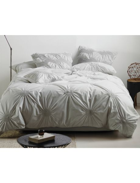 This duvet cover set features an all-over polka dot pattern in a new ruching technique, that brings romantic and naturally glamorous texture to the strongly trending shade of pale grey.