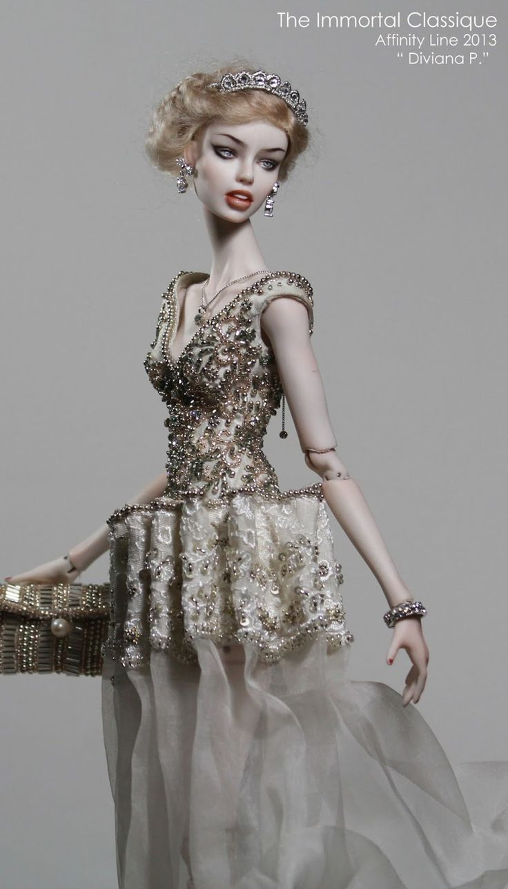 """Nu mber 1 #               The model from the aboved  picts  """"Ori Cranze """" B . """"  She's a very fine porcelain doll.  The doll com..."""