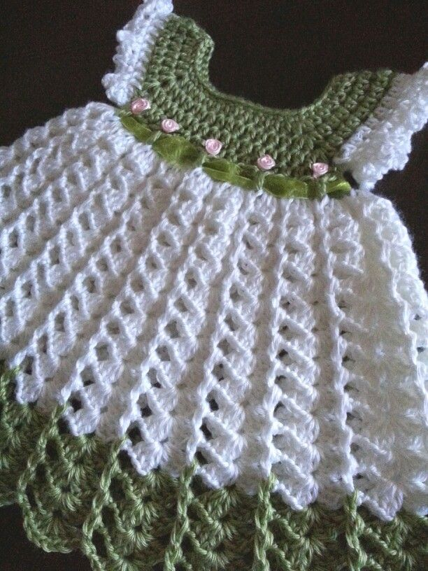 The skirt portion of this dress I used a video tutorial on YouTube. The actual color is lighter than the pic. I used Caron Simply Soft yarn White and Pistachio. This is 0 to 3 months. Linda Smith