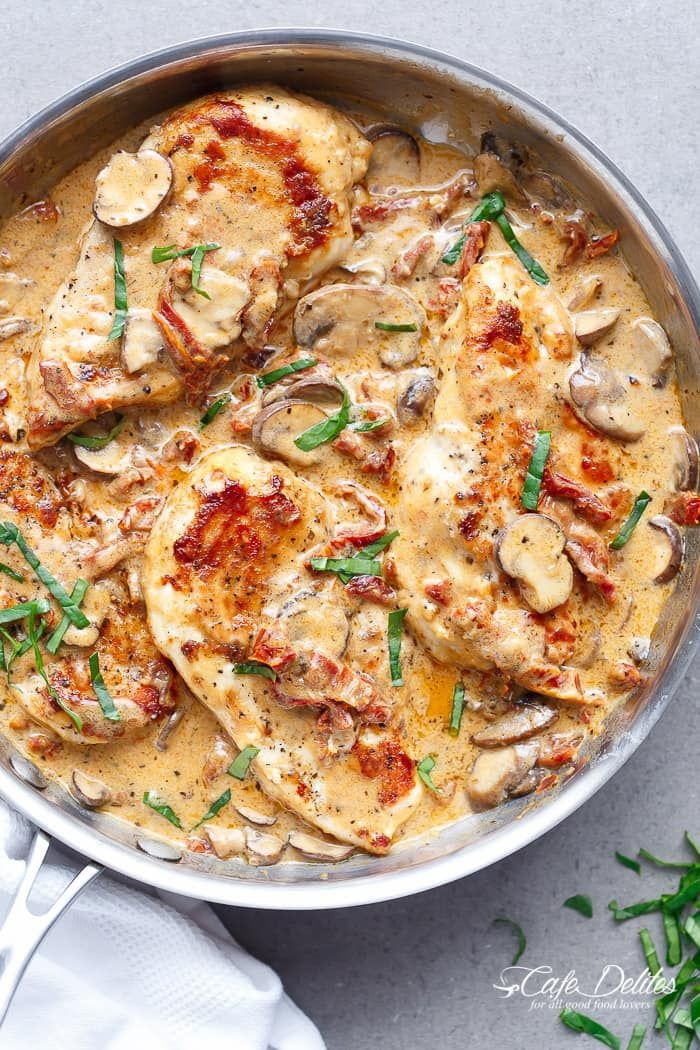 A Creamy Sun Dried Tomato Parmesan Chicken with Mushrooms that is Gluten Free and made with NO HEAVY CREAM.....or ANY cream.....at ALL! | https://cafedelites.com