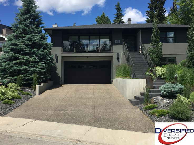 This project was completed last summer. Looks amazing, doesn't it? #diversifiedconcrete #yyc #concrete #driveway #stairs