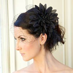 Black birdcage veil for me.. not so sure on the flower though.
