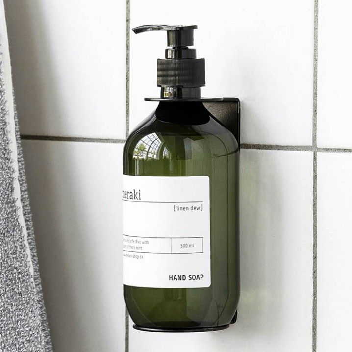 An ingenius, wall-mountable soap dispenser holder that suits Meraki 500ml bottles of soap, body wash or lotion. Add to your bathroom or powder room to keep basins clear and soap access handy. Free of parabens, colourants and endocrine disrupers.  Colour: Black  Size: 14.5cm (h)  Material: Metal