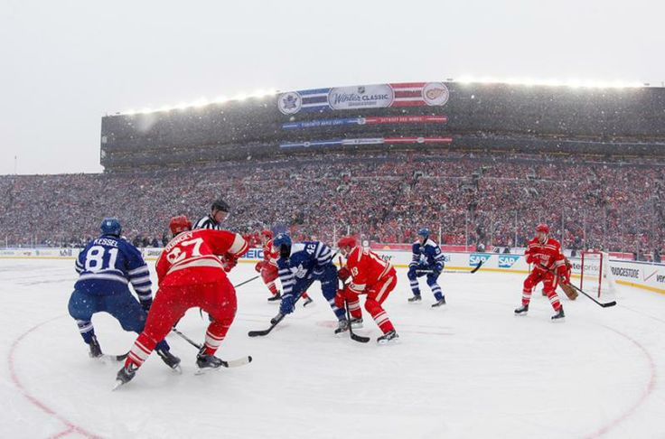 The Maple Leafs and the Red Wings face off as more than 100,000 watch at the University of Michigan's football stadium. (Paul Sancya/AP)