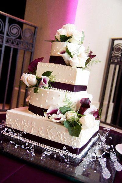 Wedding Cake #1 design But with the Blue/Purple Orchids as in the Bridal Party Bouquets Cascading from the top Down the Side... <3