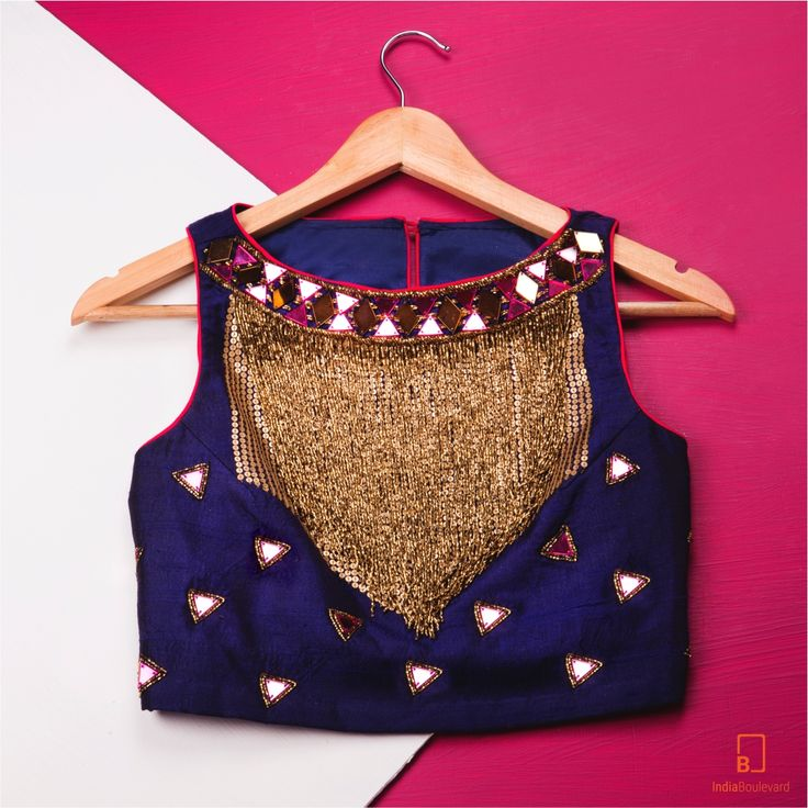 Midnight blue tank top with a pop of pink and a beaded fringe. The gold beads helps you light up the room. Pair it with a skirt, palazzos or dhoti pants to get the perfect party look. #indianfashion #indianoutfits #custommade #designdevelopdeliver #buycustom #indiaboulevard #streetstyle #summer2016