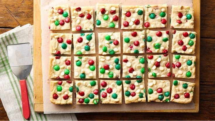 Sugar cookie M&Ms Bars - This bar is perfect to round out your cookie exchange -- colorful holiday chocolate candies, white vanilla baking chips and sugar cookie mix makes this a snap to make and bake.