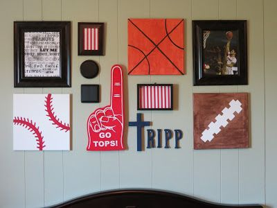 Sports themed gallery wall above crib in nursery.