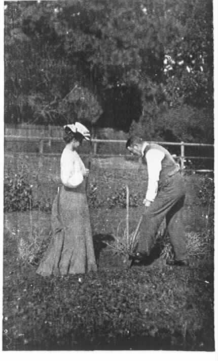 """PH 7815. """"Dunraven"""", in the garden, Mr. Fairbairn is trenching, watched by Mrs. Fairbairn; c.1904."""