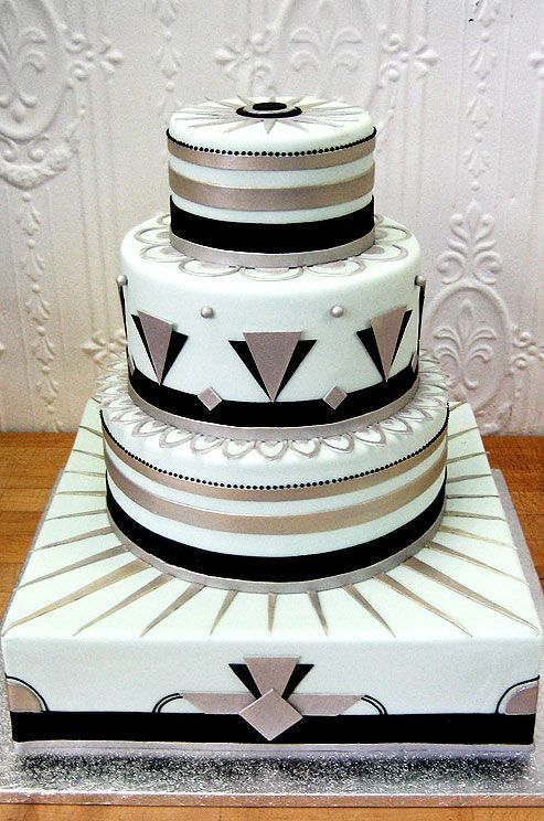 All over texture and white sugar roses, Lily of the Valley and violets add detail to three layers of white hexagonal cake.... - Fashion Diva Design | Fashion Diva Design