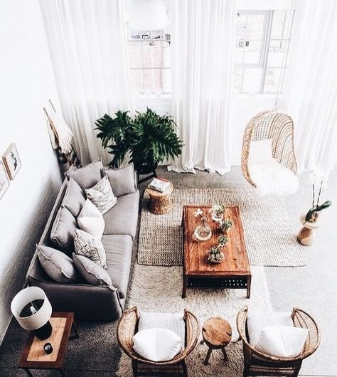 living room with hanging chair and neutral colors