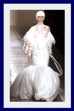 Once again I must remind you that I was hatched from an egg and my wedding dress should really reflect that.