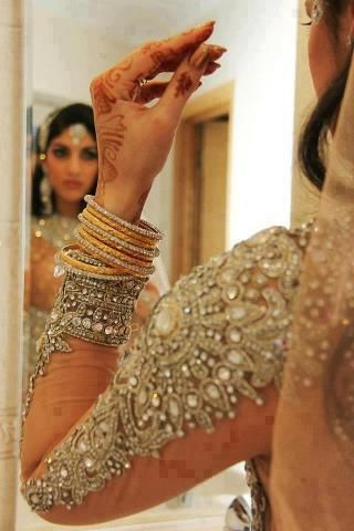 Beautiful details on long sleeves! #pink #lehnga