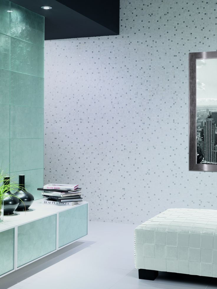 Whether it's an entire wall of mosaics or a wall of frosted textured glass. Tiles can make it happen. #tileart #tiles #mosaics #mosaictiles #glasstiles # glass #interiordesign