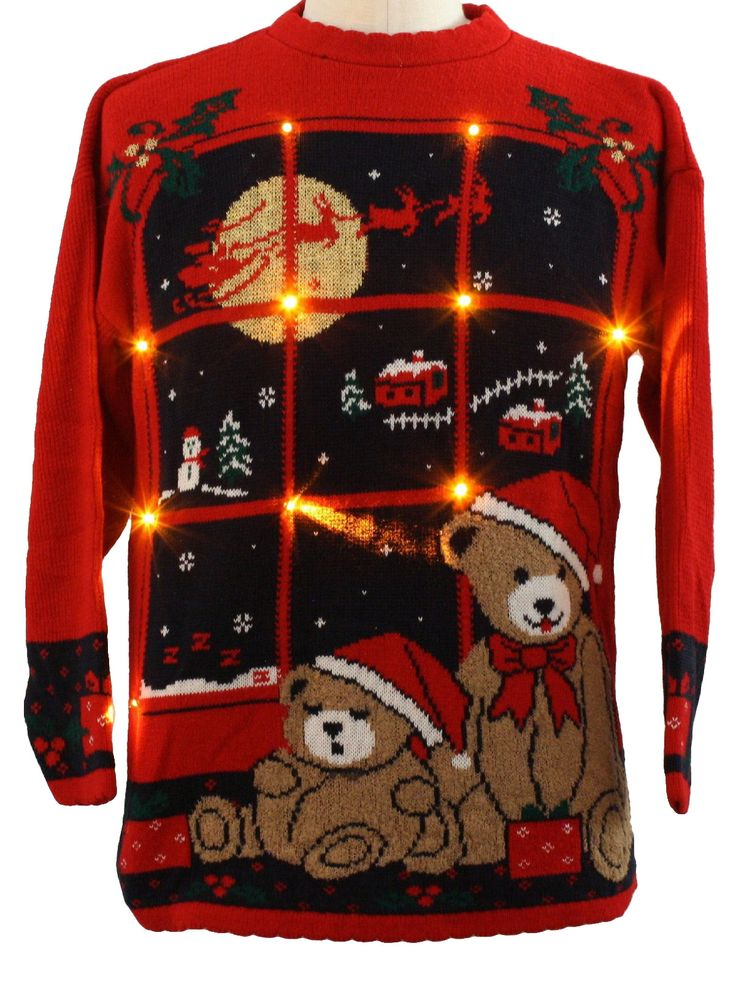 80s Style authentic vintage -Nutcracker- Unisex red background acrylic pullover longsleeve light up (10 removeable battery powered golden amber colored led Christmas flashing lights, batteries included) Ugly Christmas sweater, round neckline with a teddy bear pair sitting in front of a midnight window where reindeer fly past a brilliant golden moon above a snowman, trees and a pair of houses all mysteriously floating in the snowy night sky.