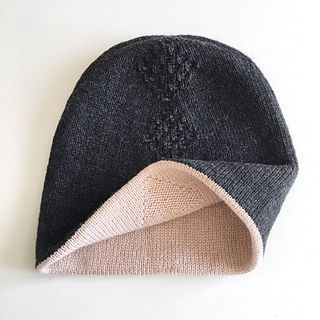 This amazing, reversible, double, seamless hat is worked in the round in one piece. Top hat has lace panel, and the bottom one has panel with textured stitch pattern. So you will have 2 hats in one!