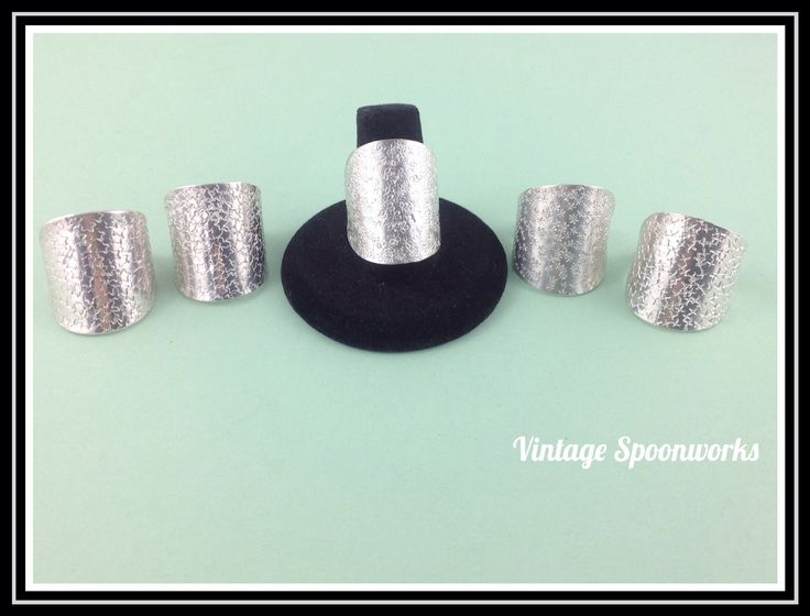 Spoon bowl rings with stamped designs.