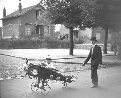 Child in pedal aeroplane - photograph by Robert Doisneau