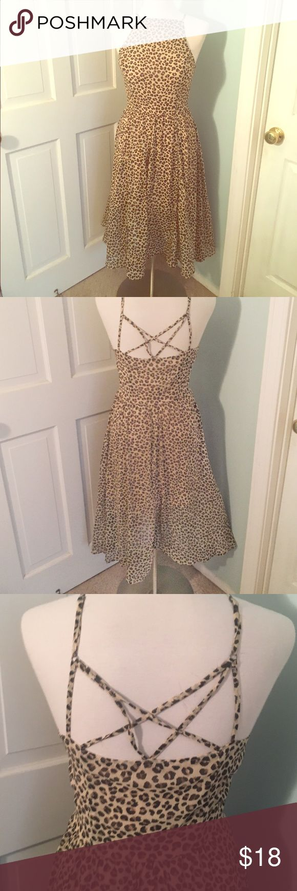 Abercrombie and Fitch cheetah print dress Brand new with tags Abercrombie and fitch cheetah tea length dress. Skinny straps with criss cross strap detail in back. Side zipper,  size medium. Straps have some fraying but not very noticeable. High neck detail. Chiffon. Abercrombie & Fitch Dresses Midi