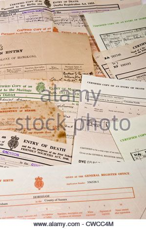 Some birth, death and marriage certificates, originals and copies. - Stock Photo