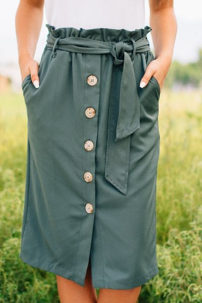 8c8d5e5207 Olive toned, button front skirt with a tie waist and ruffle top detail!