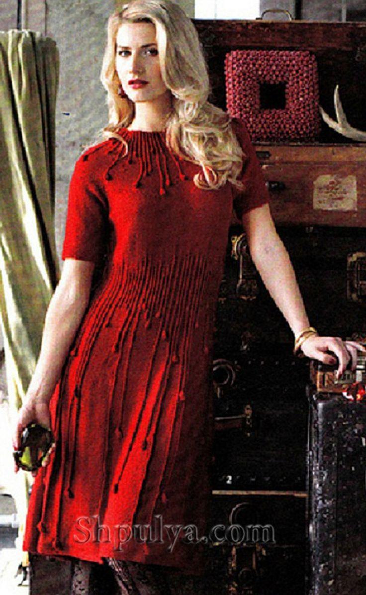 Размер: S, M, L Вязаное спицами платье с узором капельки дождя. Платье спицами с короткими рукавами и расклешенного силуэта. Платье связано из пряжи красного цвета.