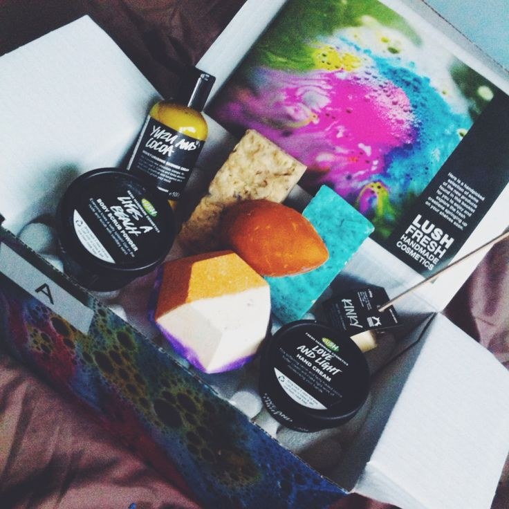 Lush anniversary box A for Lush staff. Includes: Yuzu and Cocoa shower gel, the Experimenter bath bomb, Pumice Power foot scrub, Life's a Beach shower scrub, Odango solid shampoo, Outback Mate soap, Kinky Hot oil hair treatment, and Love and Light hand cream. SO. MANY. TREATS.