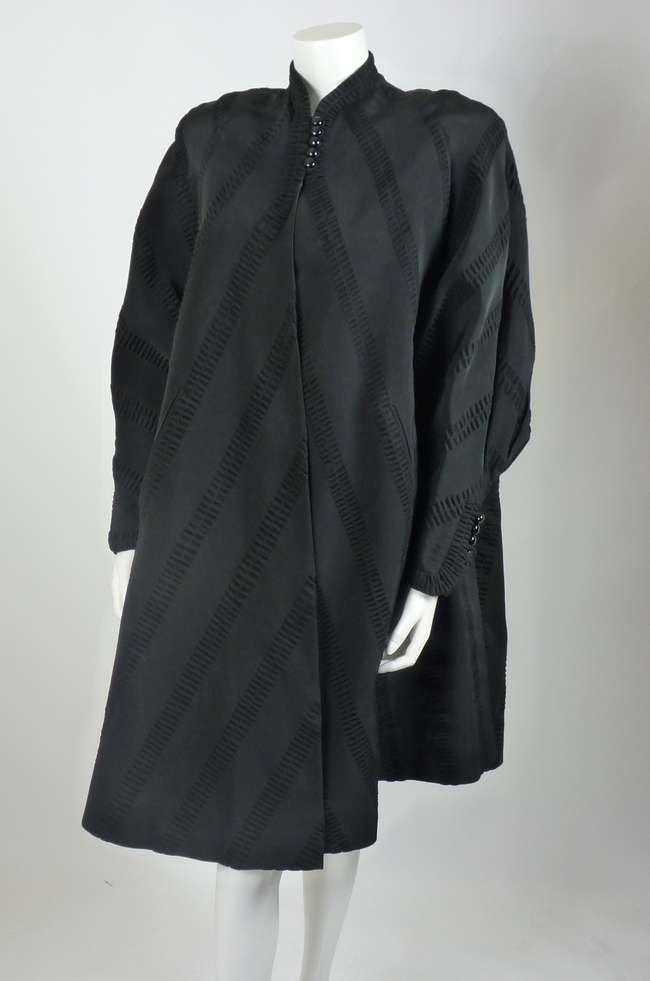A Harvey Nichols black evening coat, c.1950, in a hea | Lot 209 | 17 Sworders Auctioneers