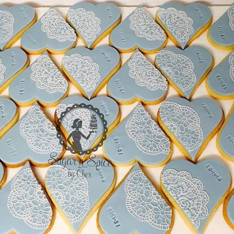 Pretty wedding cookies favours in cornflower blue with white edible lace #sugarnspicebycher