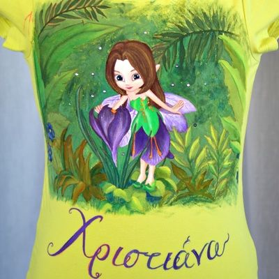 Hand painted t shirt. I use non-toxic, water based, permanent fabric colors. | It's a forest flower fairy. Some clear rhinestones were added in the background, for that extra bling every girl wants! The kid's name (Christiana) is written in Greek.