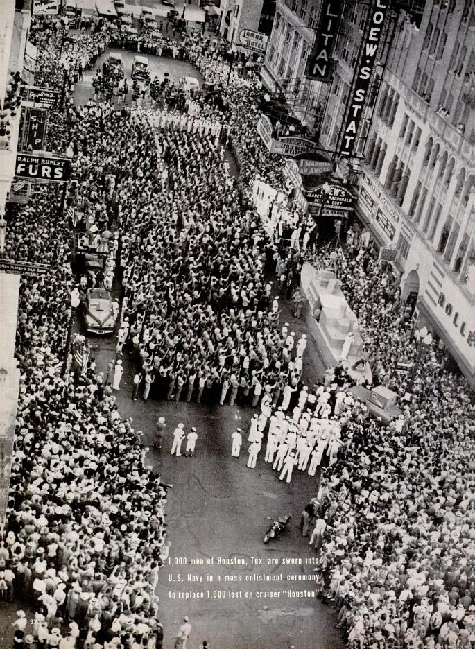 """1,000 men of Houston, Texas, are sworn into the U.S. Navy in a mass enlistment ceremony to replace the 1,000 men lost on the cruiser, """"Houston."""" - 1942"""
