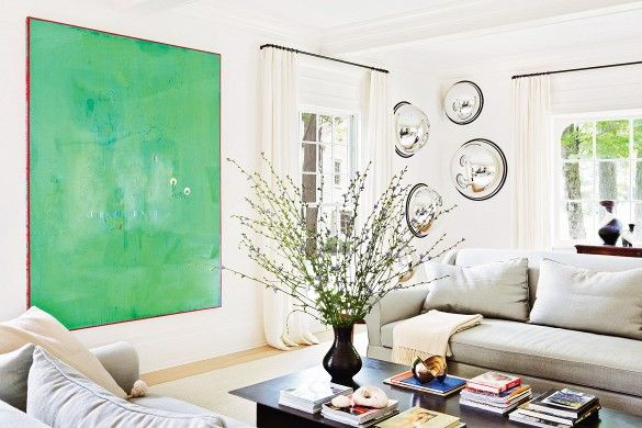 This Amazing Home is a Lesson in Sophisticated Décor// oversized art, green painting, coffee table styling