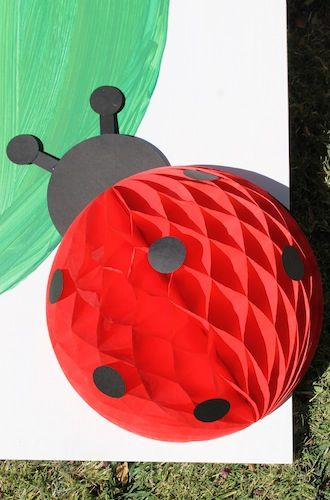A ladybug made out of a red honeycomb ball!
