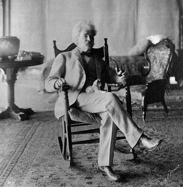 Mark Twain Holding Cat on Lap