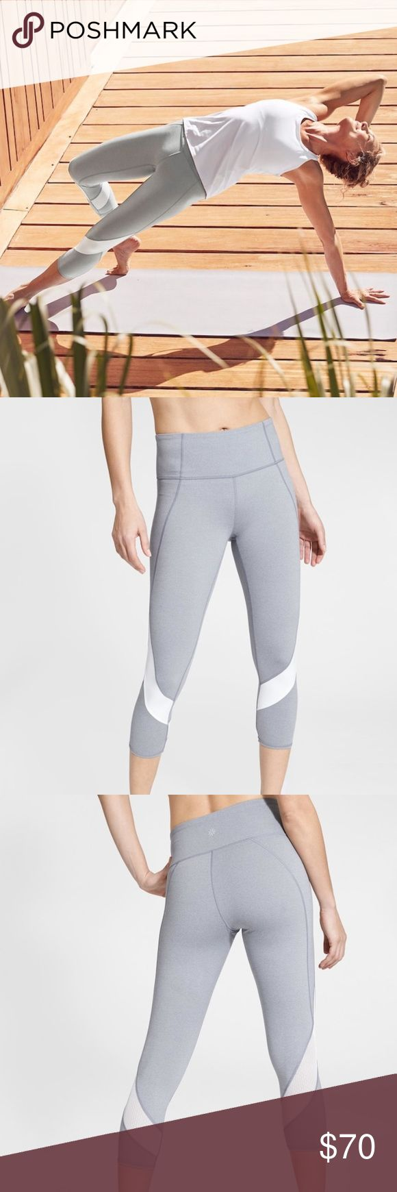 Athleta Colorblock Mesh Salutation Capri XS NWT  Size XS *the grey is slightly darker in person (as shown in my photo) rather than how light they look in the stock photo.   Capri made from Powervita fabric to deliver unbelievable softness and lightweight compression, with mesh panels for added breathability and an Unpinchable, high-rise waistband for smooth coverage. INSPIRED FOR: yoga, studio workouts Mesh panels for extra ventilation Hidden key envelope pocket Breathable CoolMax® crotch…