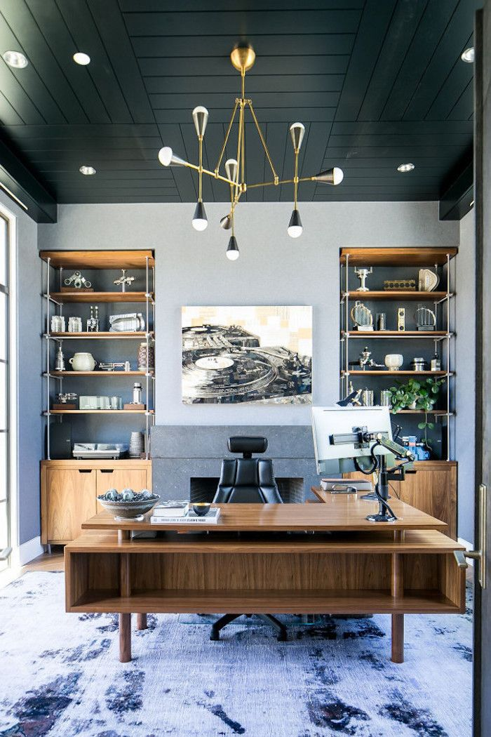 Blue Rug On The Floor Wooden Desk With Black Leather Armchair Office Decor Ideas Wooden Bookcas Home Office Design Office Interior Design Modern Home Office