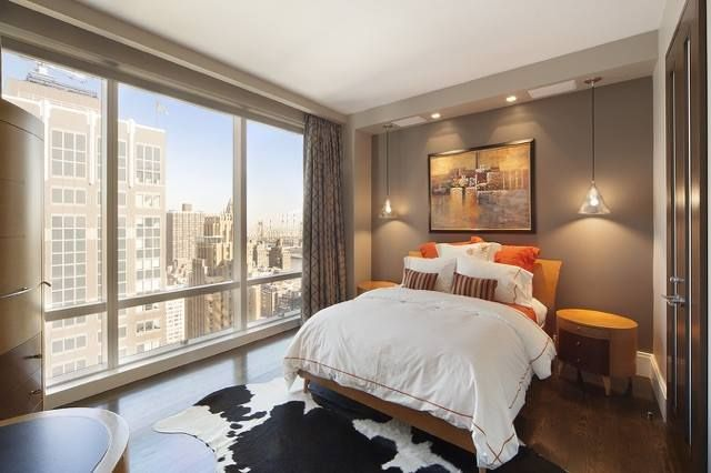 Lutron Motorized Drapes by NY City Blinds adorn this bedroom at UN Plaza.