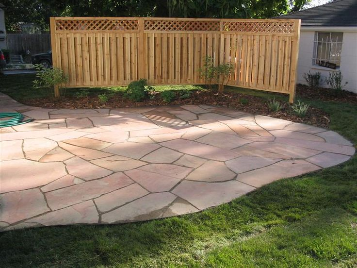 patio privacy ideas dry lay red flagstone patio with privacy fencing - Patio Fencing Ideas