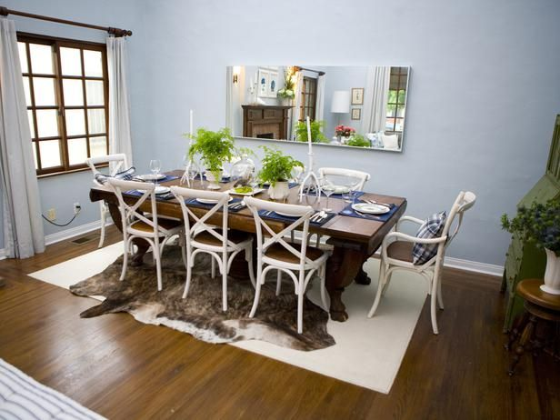 This Soft Blue Gray Dining Room Pairs Together Modern Style With Traditional Elements Giving The Space An Eclectic Feel Animal Hide Area Rug Sits