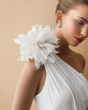 Add a dramatic flower to your dress. Learn how to make this fabric dahlia: http://www.marthastewartweddings.com/231155/how-make-paper-and-fabric-wedding-flowers/@center/272429/diy-weddings#99265