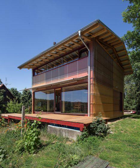 Corrugated plastic cladding reveals the timber structure of this house by Czech architects Matěj Petránek and Adam Jirkal, which replaces a family holiday home near Prague.