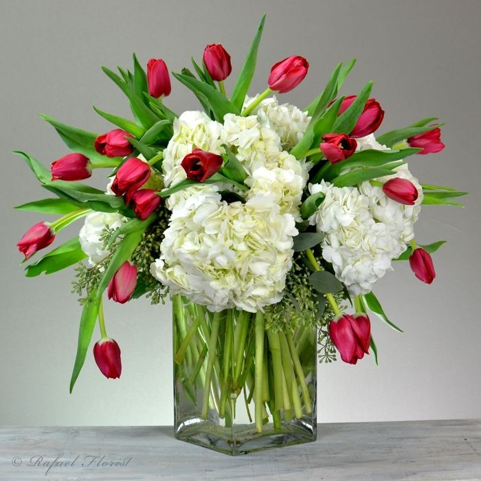 Cascading Red Tulips And White Hydrangea Floral Centerpiece Christmas Flower Arrangements Tulip Centerpiece Tulips Arrangement